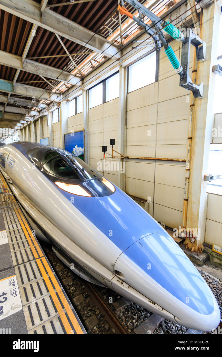 Japan, Hiroshima station. Shinkansen, blue and grey 500 series Kodoma bullet train at platform. - Stock Image