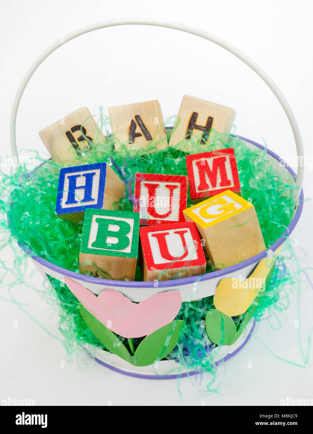 Easter basket filled with grouch's BAH HUMBUG sentiment. - Stock Image