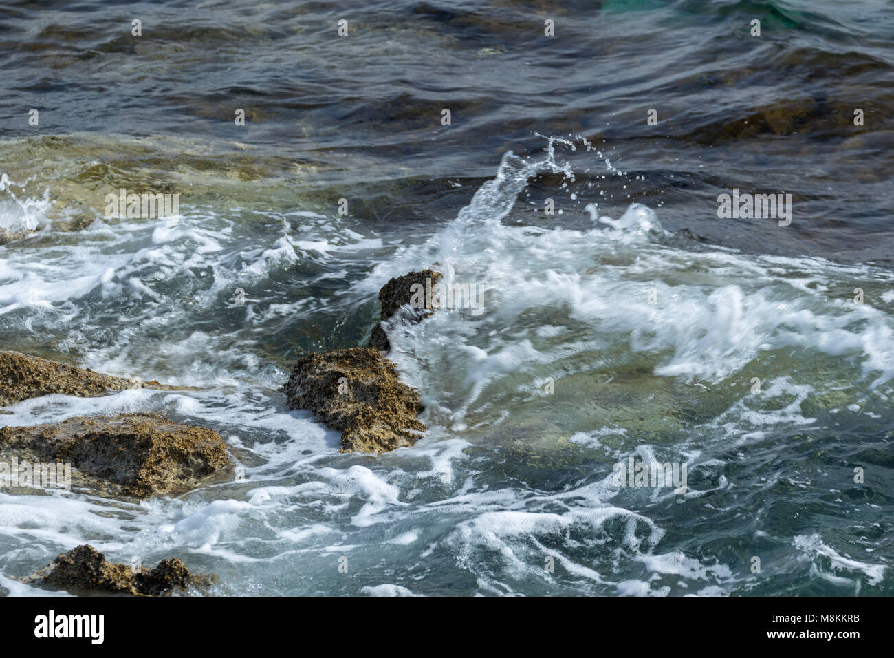 Splashing water abstract of the Mediterranean sea in Paphos harbour, Cyprus - Stock Image