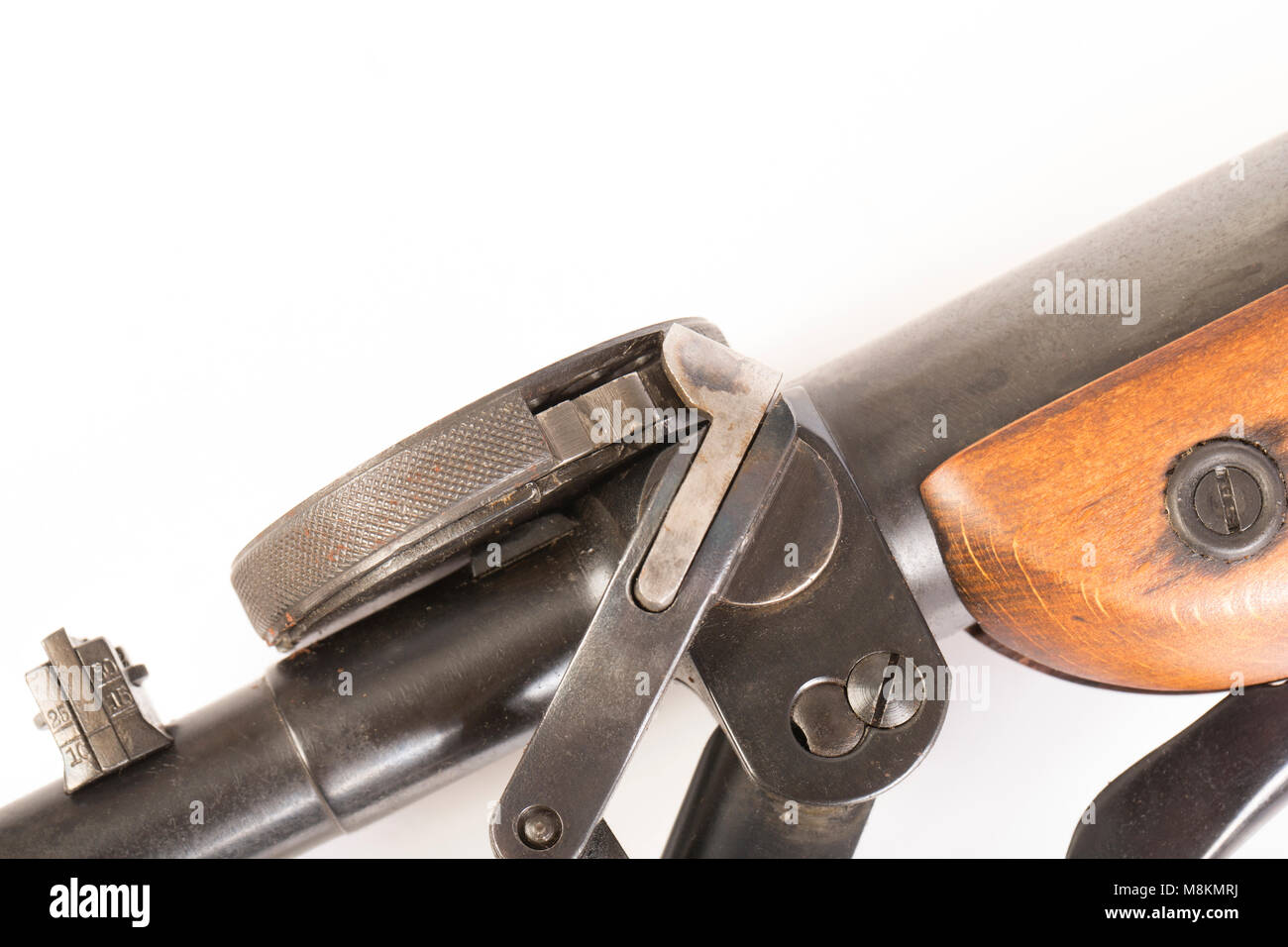 A .177 German Haenel Model 5 Junior repeater air rifle showing the lever that rotates the drum magazine. England - Stock Image