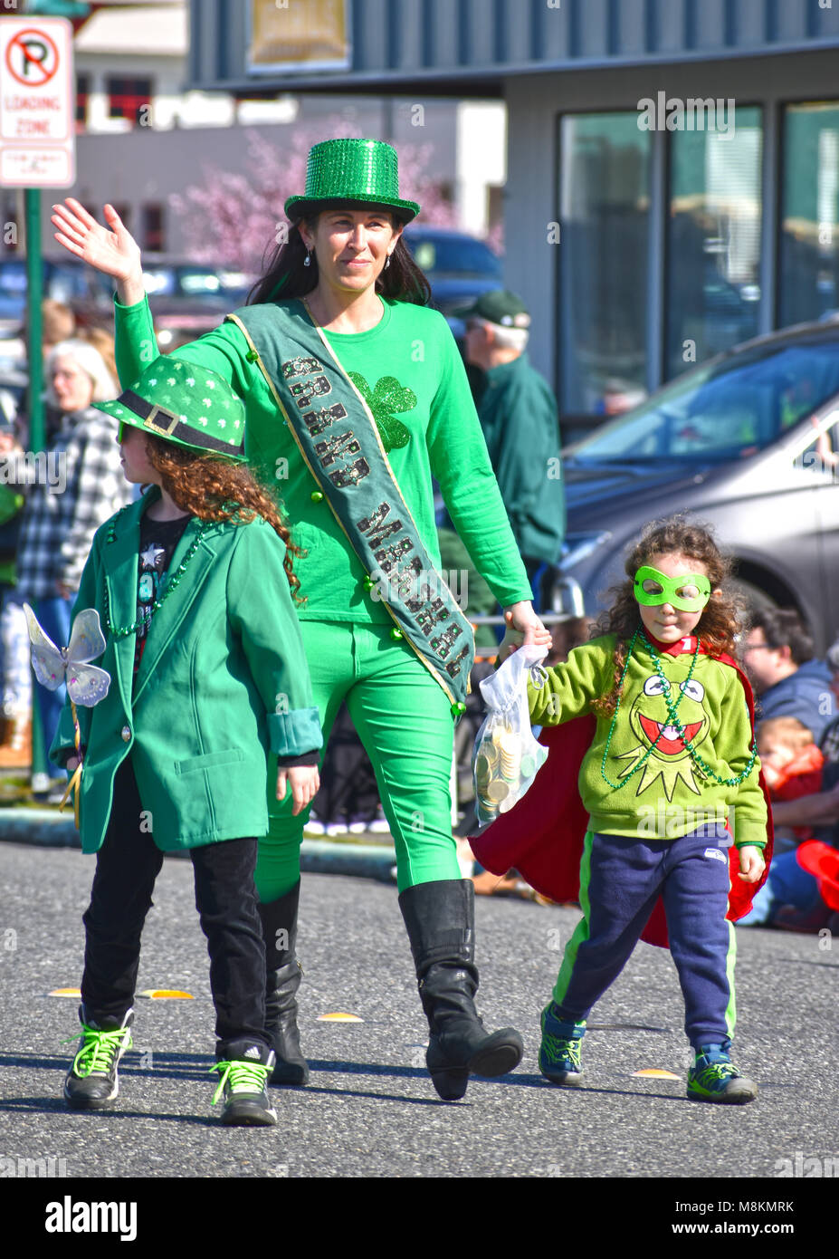 St. Patrick's Day Parade in Bellingham, Washington, USA.  The grand marshal is waving her hand at the crowd while Stock Photo