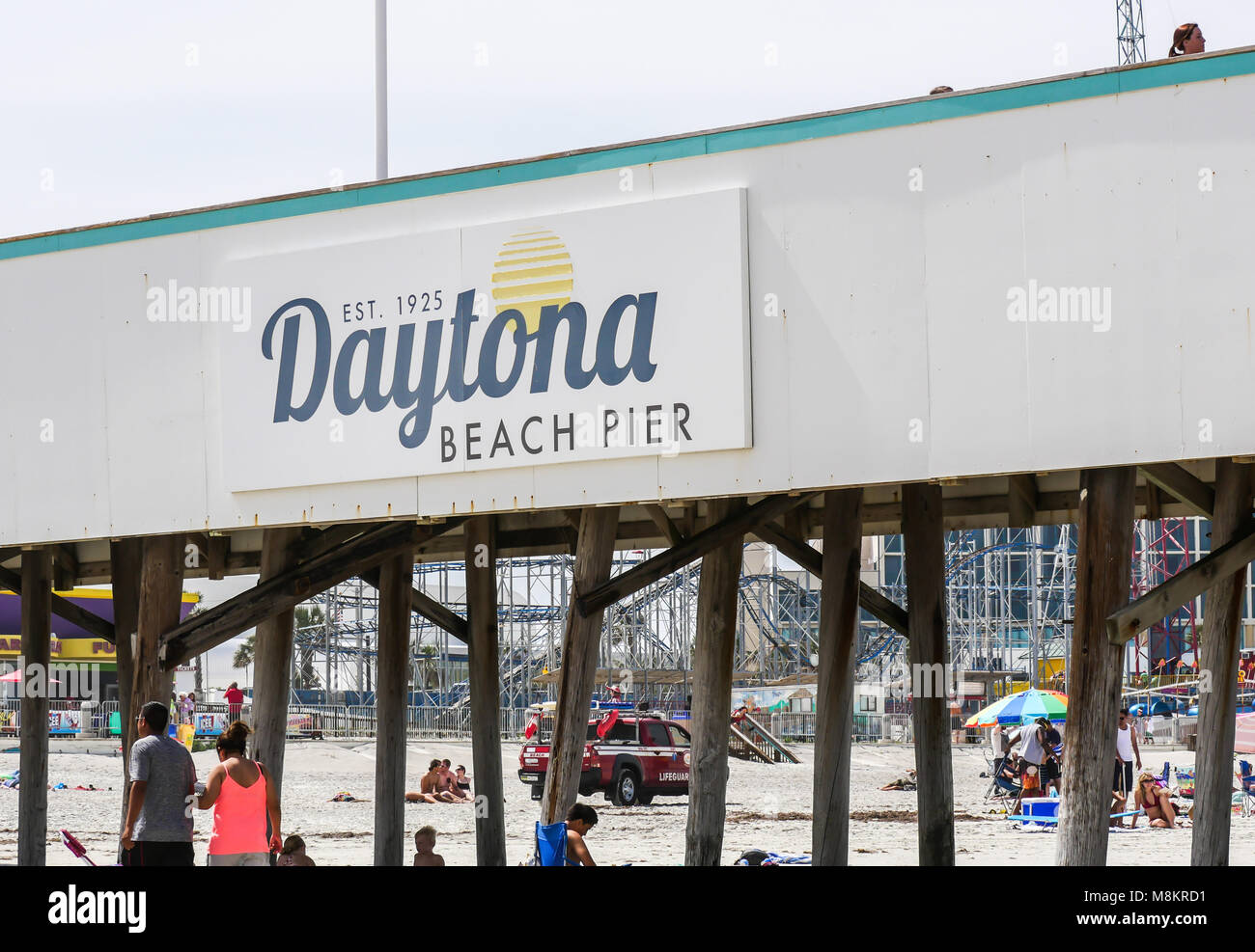DAYTONA BEACH, FLORIDA - APRIL 15, 2017: The famous historic Daytona Beach Pier is a popular vacation spot to visit Stock Photo