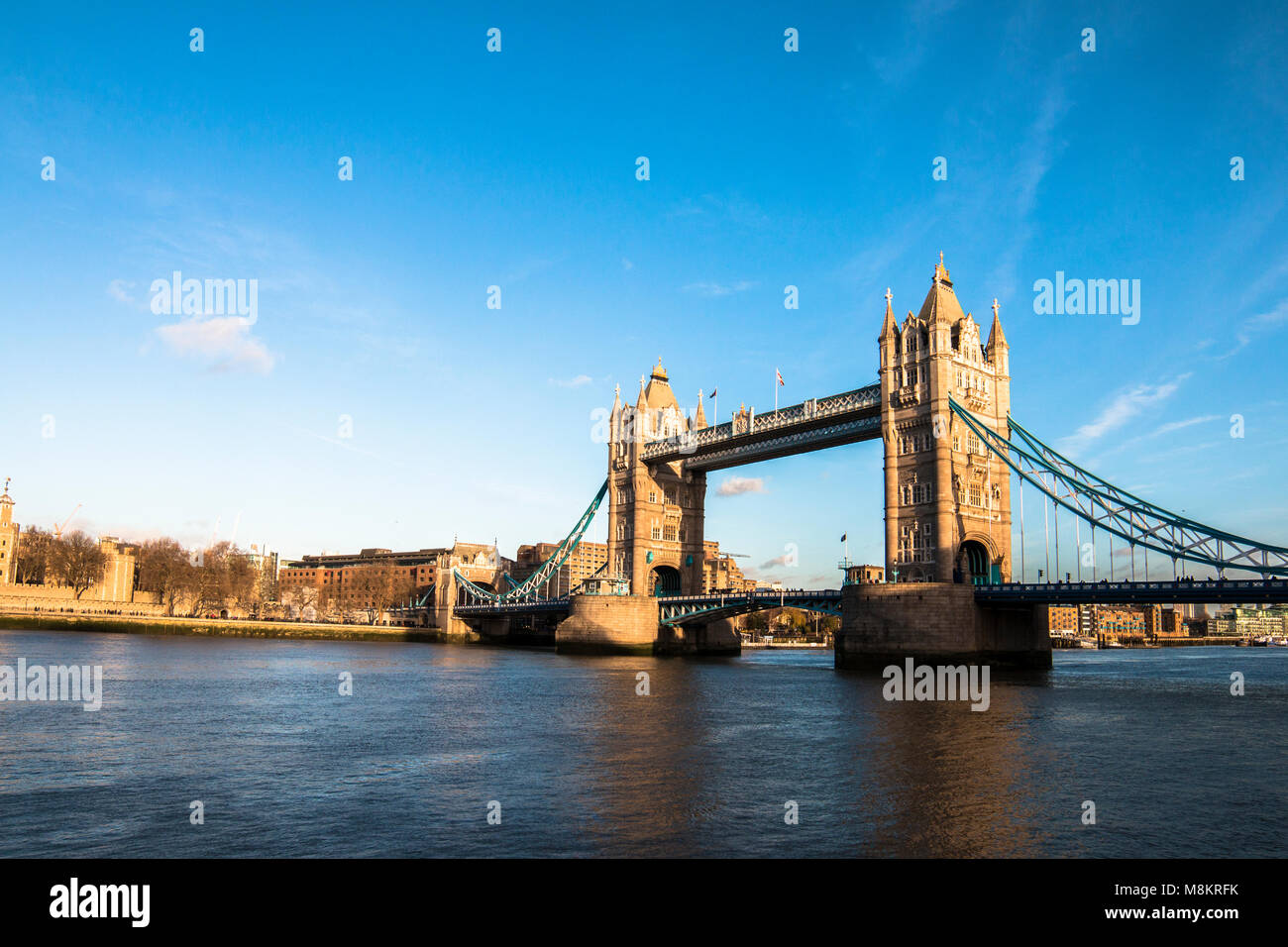 Tower Bridge is a combined bascule and suspension bridge in London built between 1886 and 1894. The bridge crosses - Stock Image
