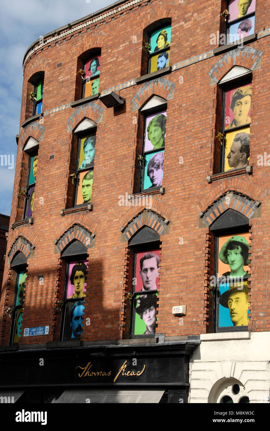 Portraits of members of the 1916 Irish Citizens Army in the windows of a building in Parliament Street, Dublin - Stock Image