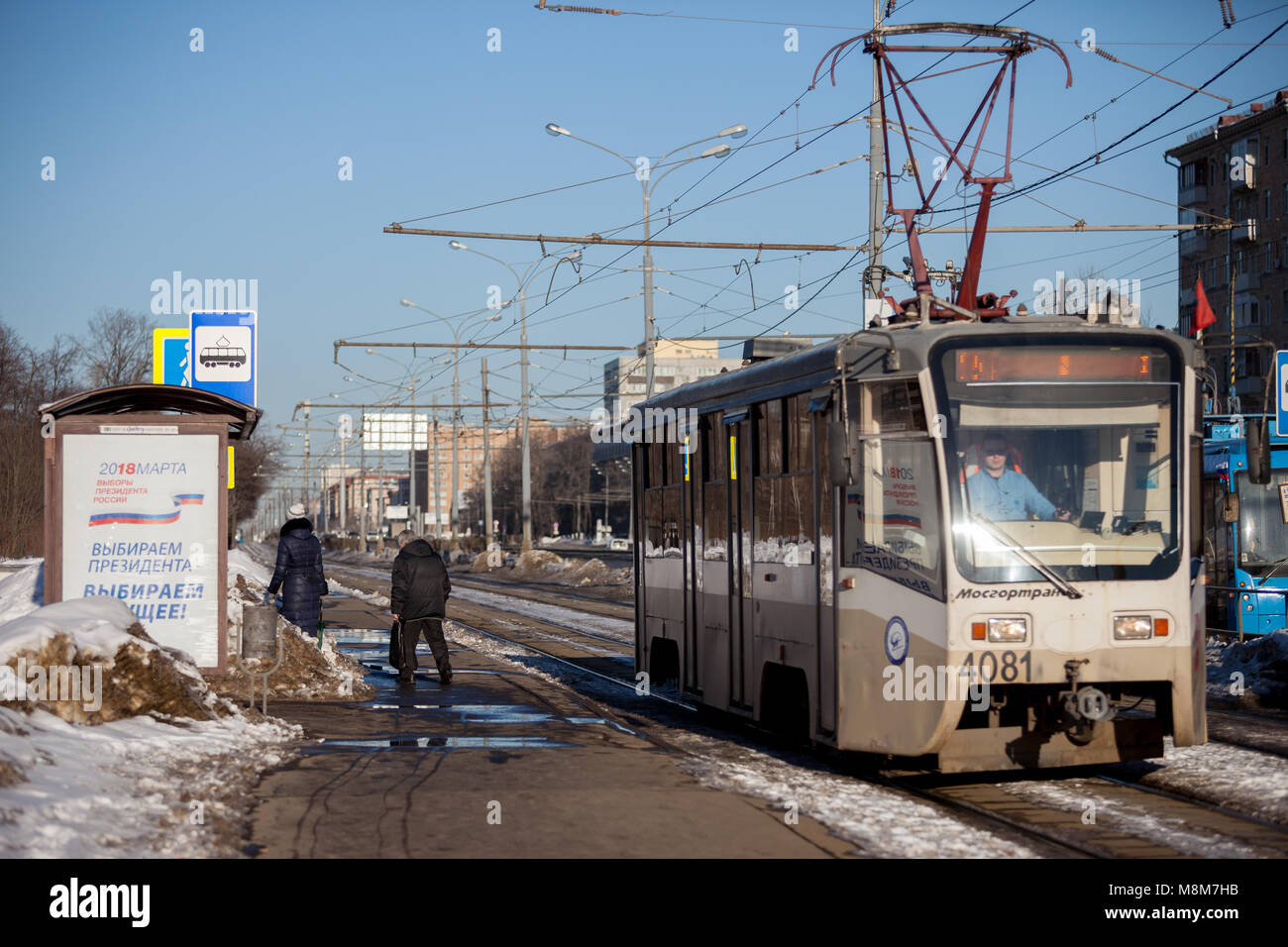 MOSCOW, RUSSIA - MARCH 18, 2018: A poster at a tram stop calling for voting for the election of the President of - Stock Image