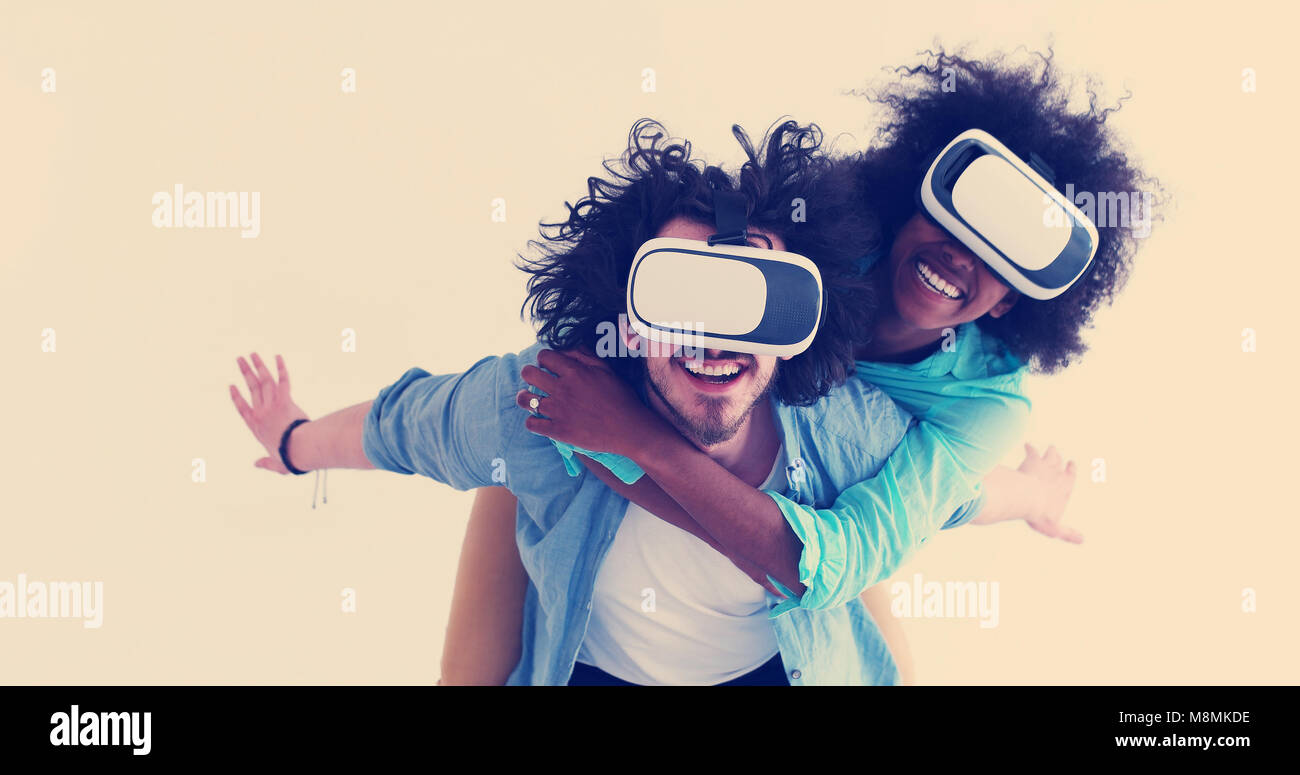 4daa4e11819f Happy multiethnic couple getting experience using VR headset glasses of virtual  reality
