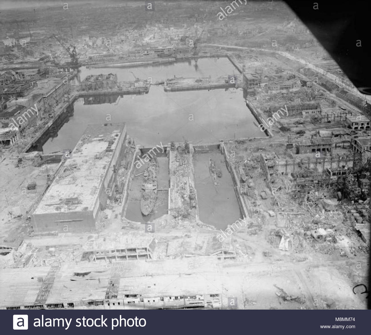 Germany Under Allied Occupation Low Level Oblique Aerial Photograph Of The Devastation Caused To German Naval Docks At Kiel