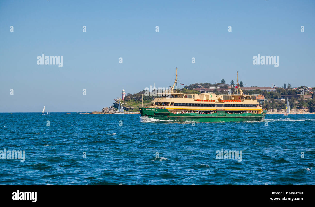 the Manly Ferry Service MV Freshwater ploughing Sydney's North Harbour enroute to Manly, against the backdrop - Stock Image