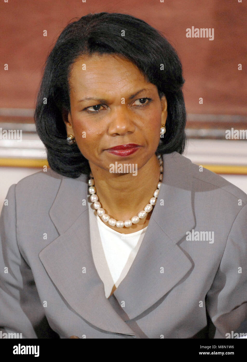 United States Secretary of State Condoleezza Rice listens as US President George W. Bush announced she would be - Stock Image