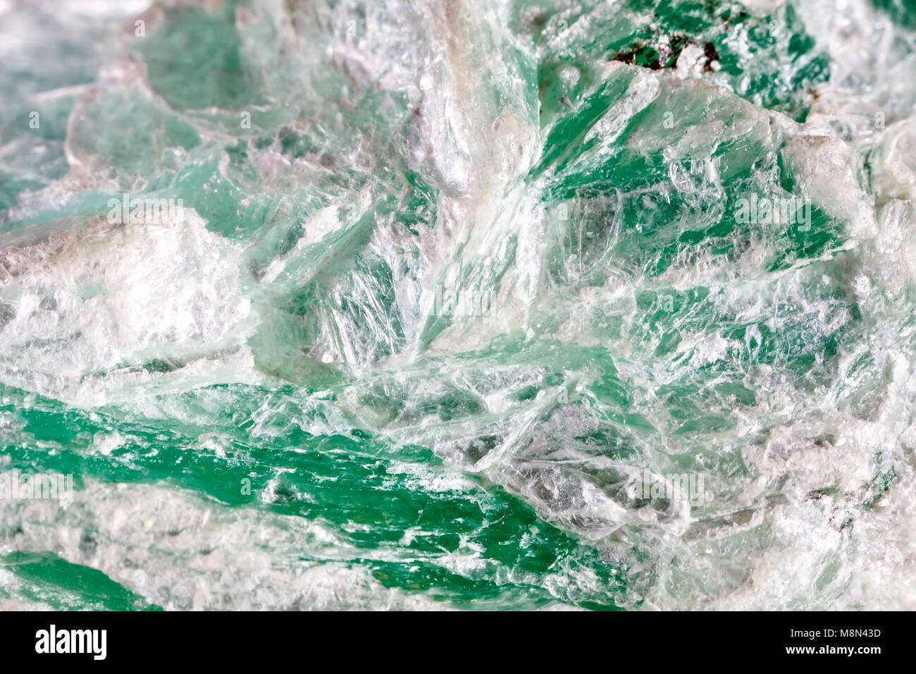 Macro shooting of natural gemstone. The raw mineral is talc. - Stock Image