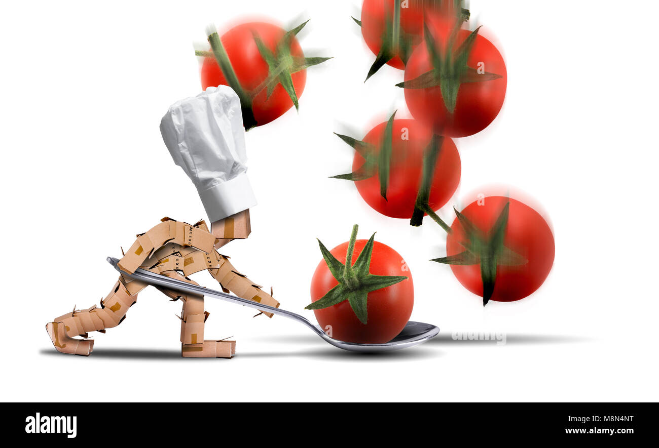 Chef box character holding a large spoon catching tomatoes as they fall. White hat and white background. Cooking, - Stock Image