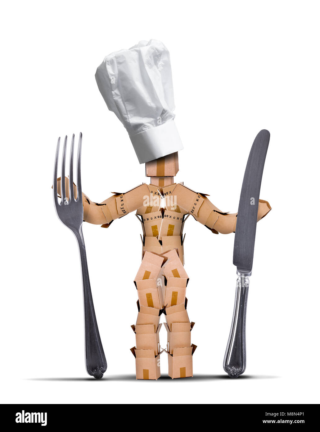 Chef box character with tall chef hat holding big knife and fork against a white background. Cooking and kitchen - Stock Image