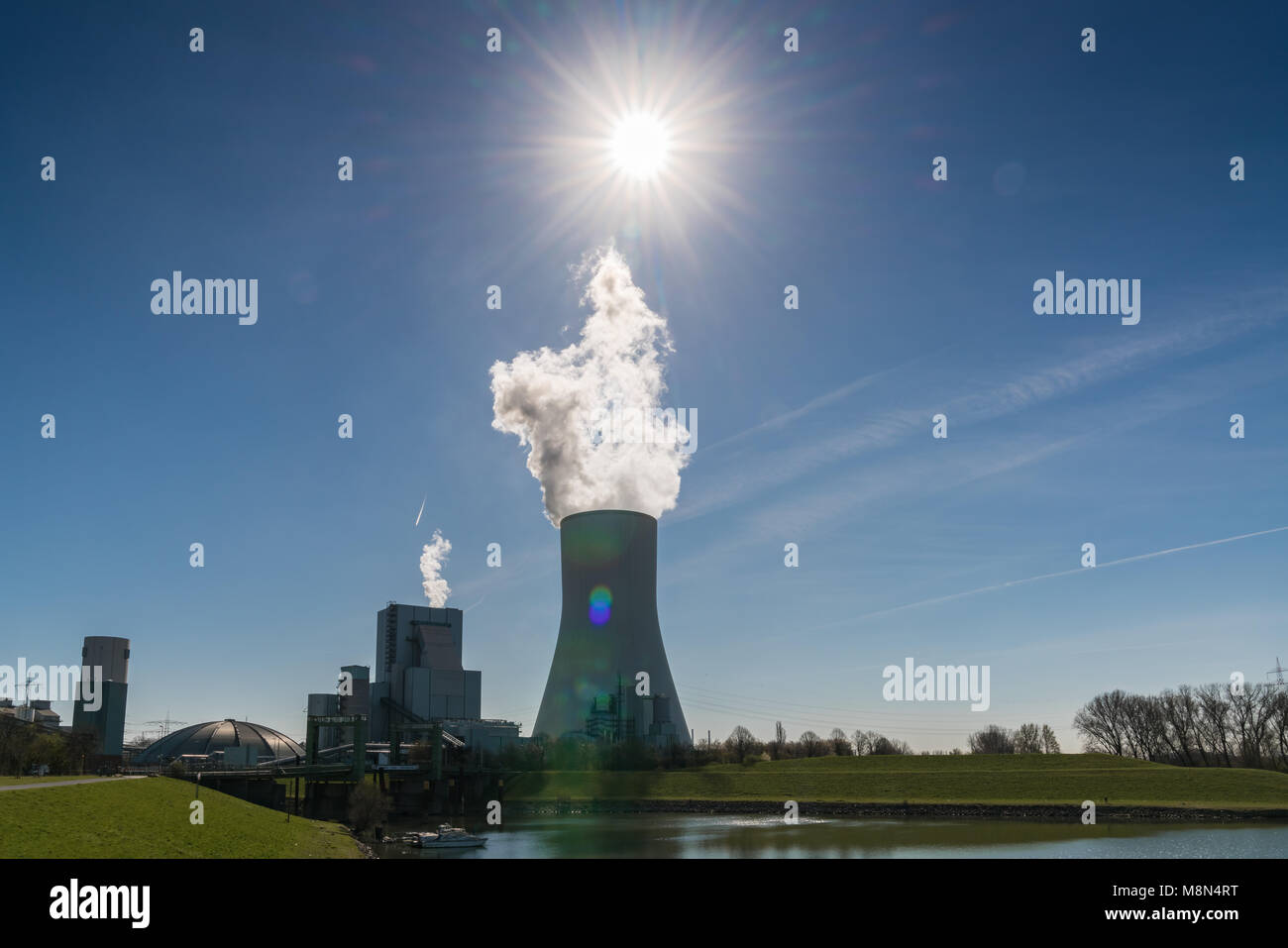 Duisburg, North Rhine-Westphalia, Germany - March 27, 2017: Power Station Walsum with some smoke and a sunstar - Stock Image