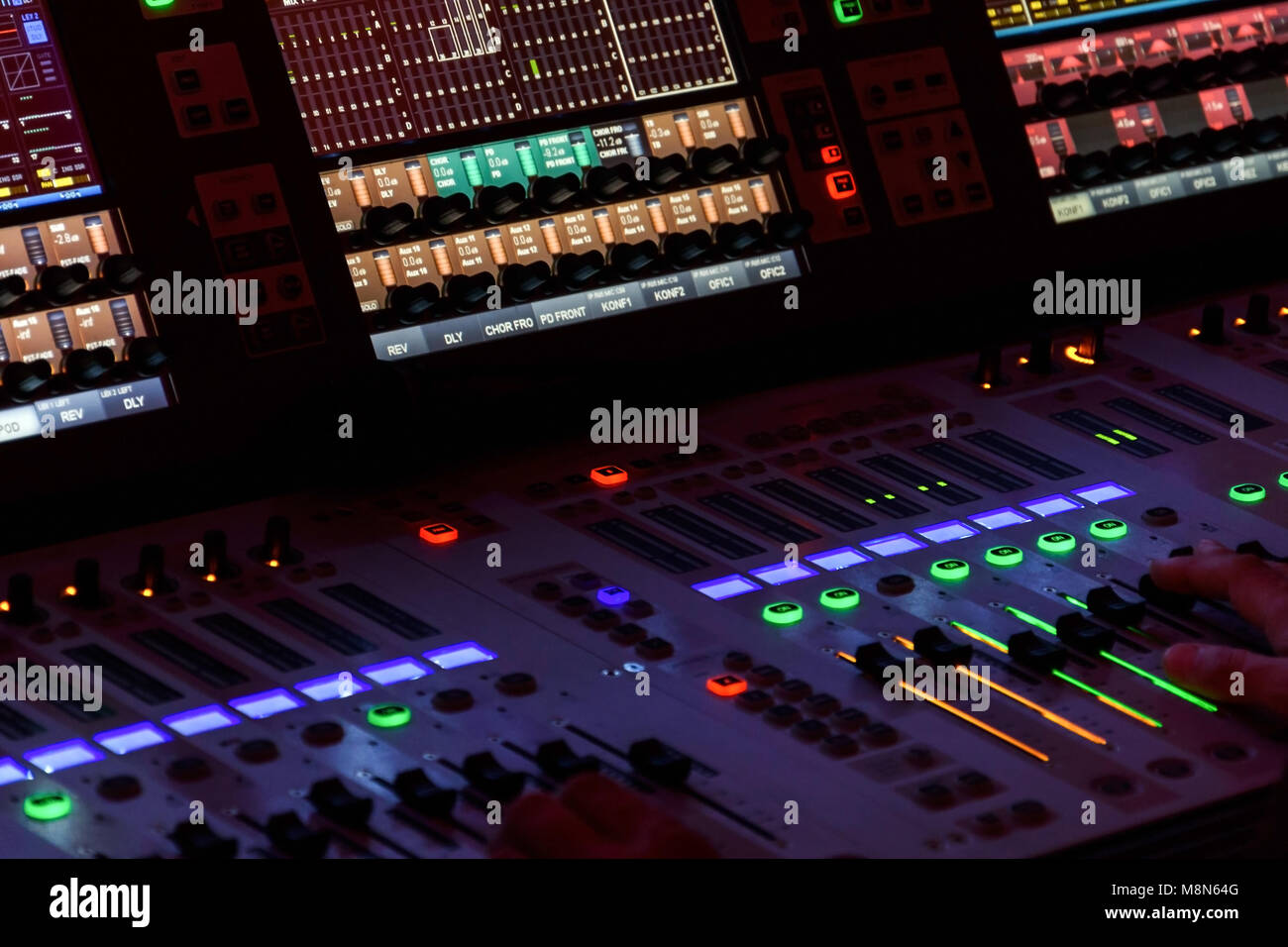 Director working on the video or sound mixing console in the studio - Stock Image