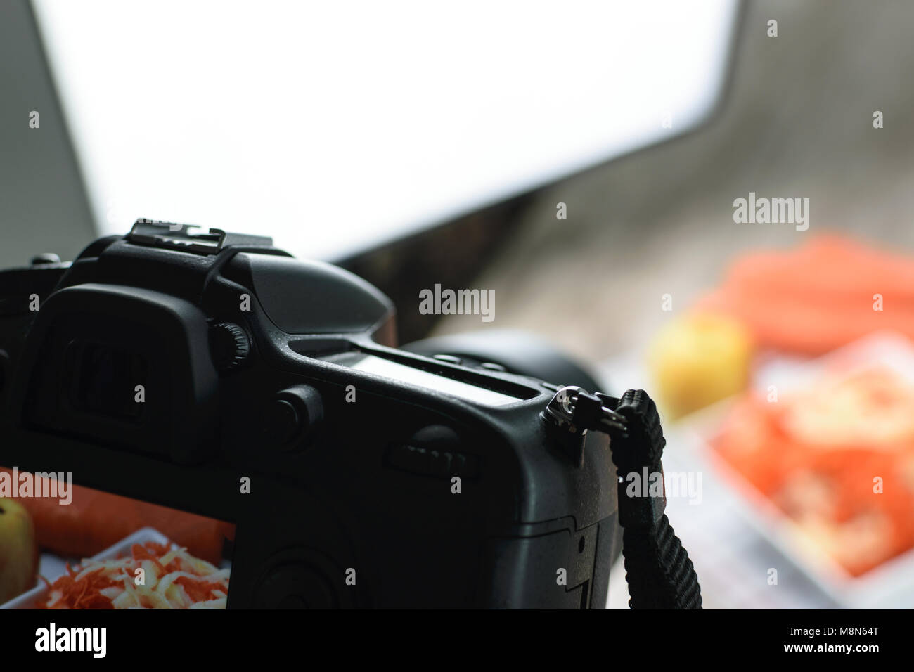Concept image  -  rear view of DSLR camera making a food photography in the photo studio - Stock Image