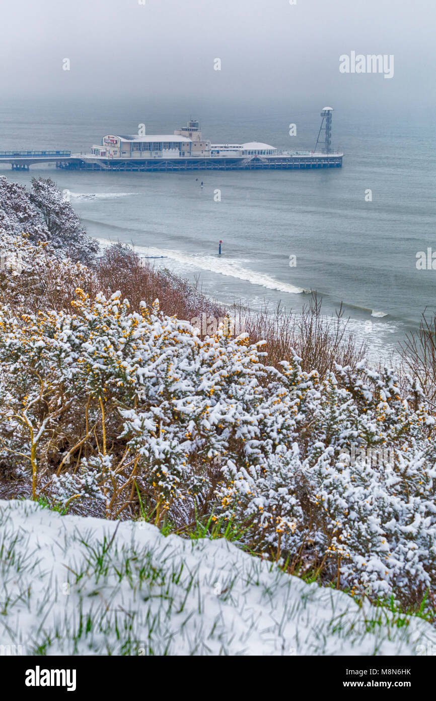 View over Bournemouth beach and Bournemouth pier covered in snow, Bournemouth, Dorset, England UK in March Stock Photo