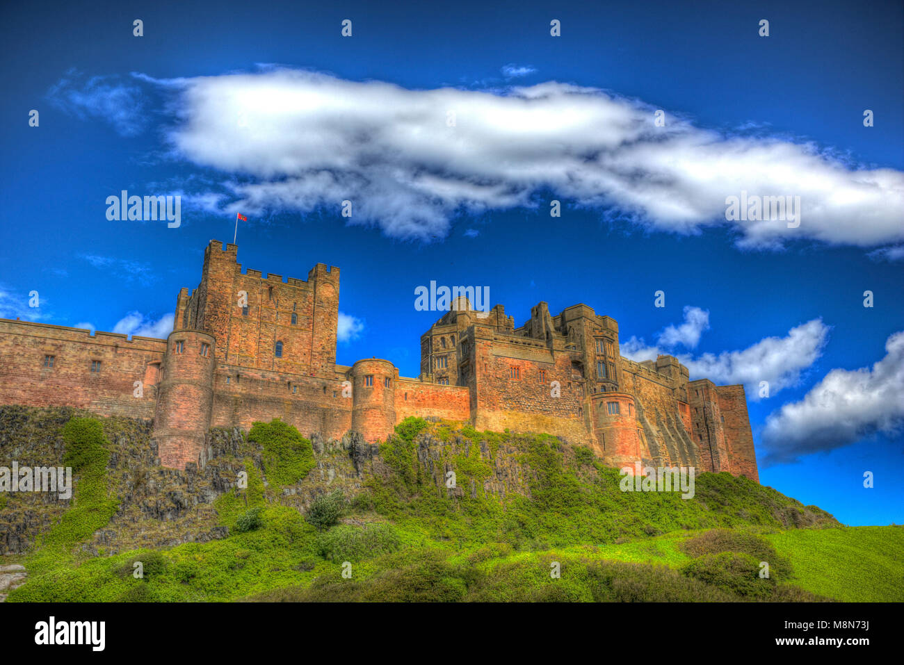 English medieval castle Bamburg Northumberland on hill in bright colourful hdr - Stock Image