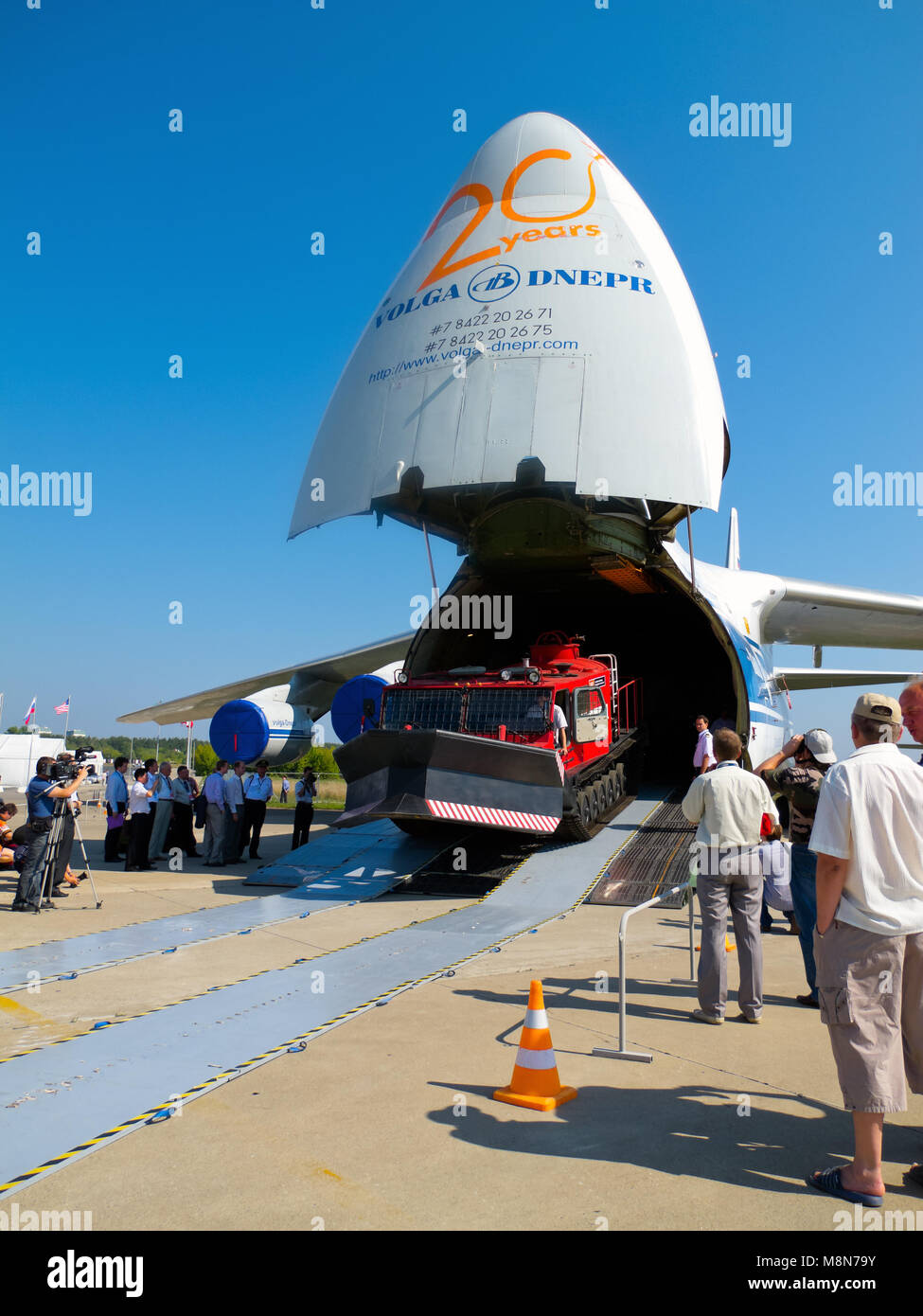 AN 124 100 Antonov Volga Dnepr jet airplane unloading, front ramp down, nose up at International Aviation & Space Stock Photo