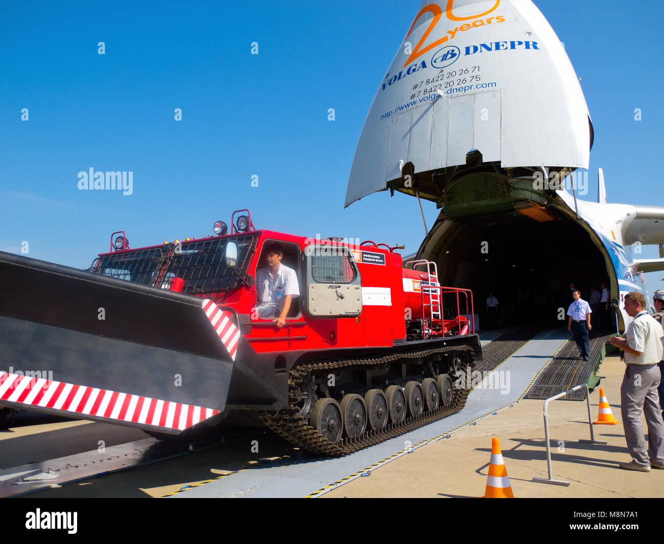 AN 124 100 Antonov Volga-Dnepr unloading the tracked vehicle at International Aviation & Space Salon in Moscow MAKS. Stock Photo