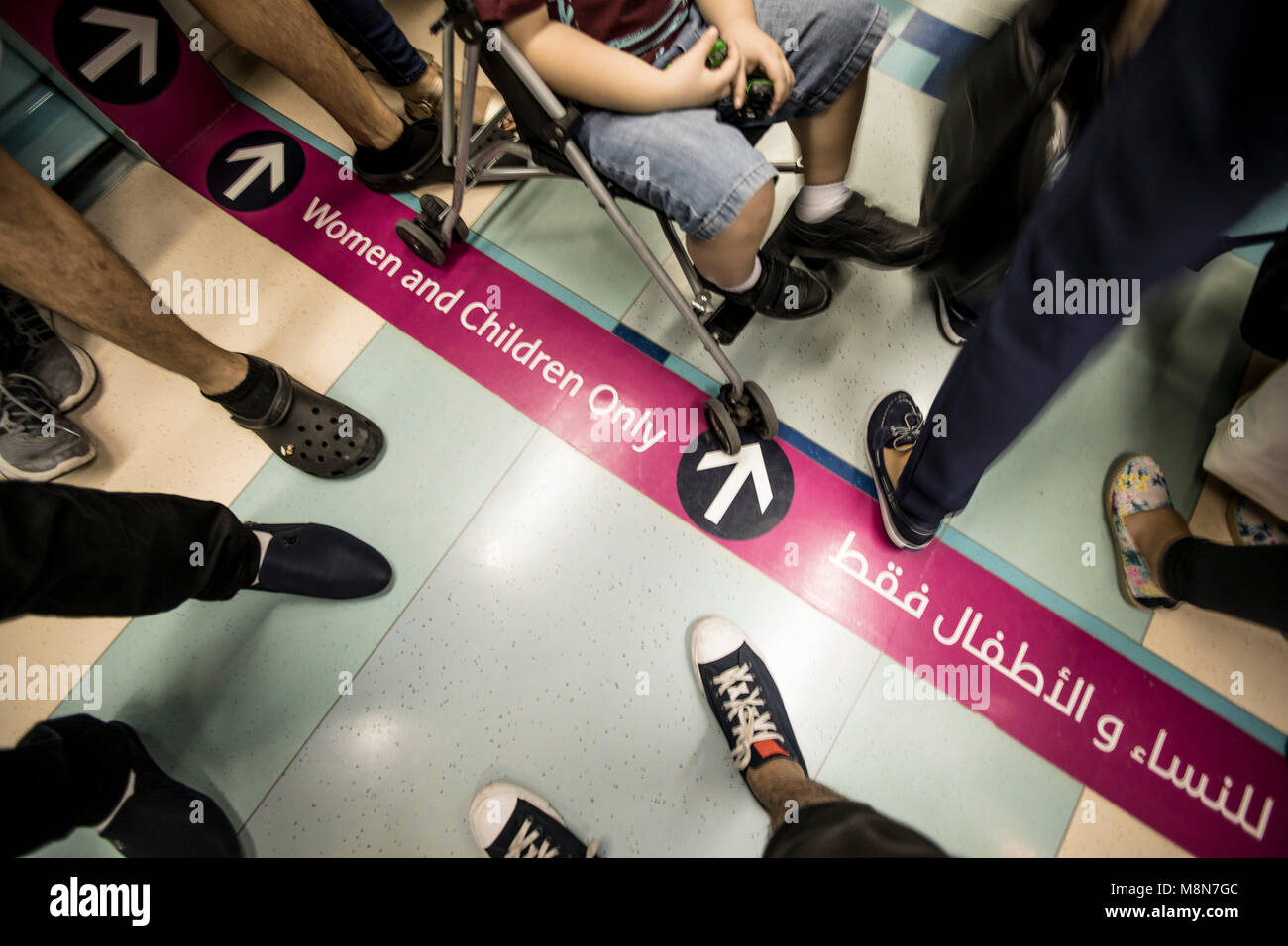 Passengers, women-only passenger car, The Dubai Metro - Stock Image