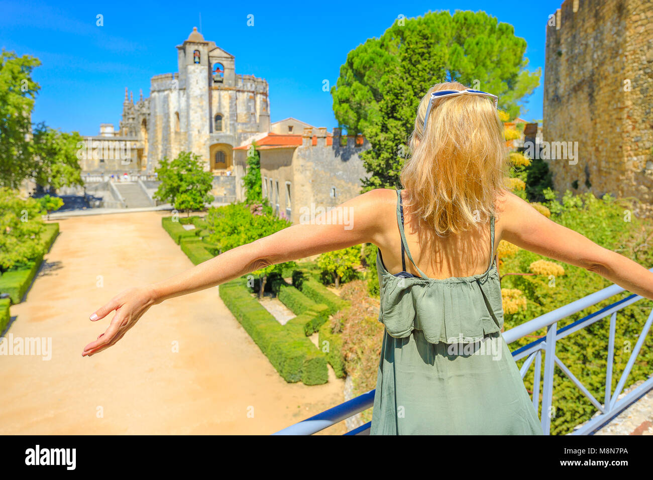 Tourism in Portugal. Freedom lifestyle woman at Templar Monastery or Convent of Christ on blurred background. Female Stock Photo