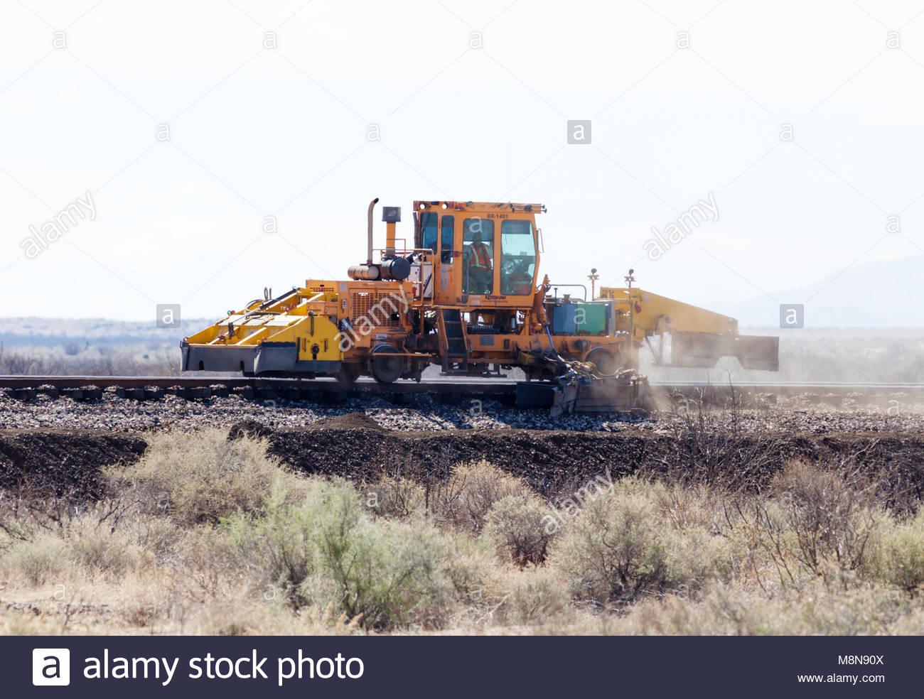 Kershaw Ballast Regulator Machine on railroad tracks in southeastern Arizona, USA, operator visible - Stock Image