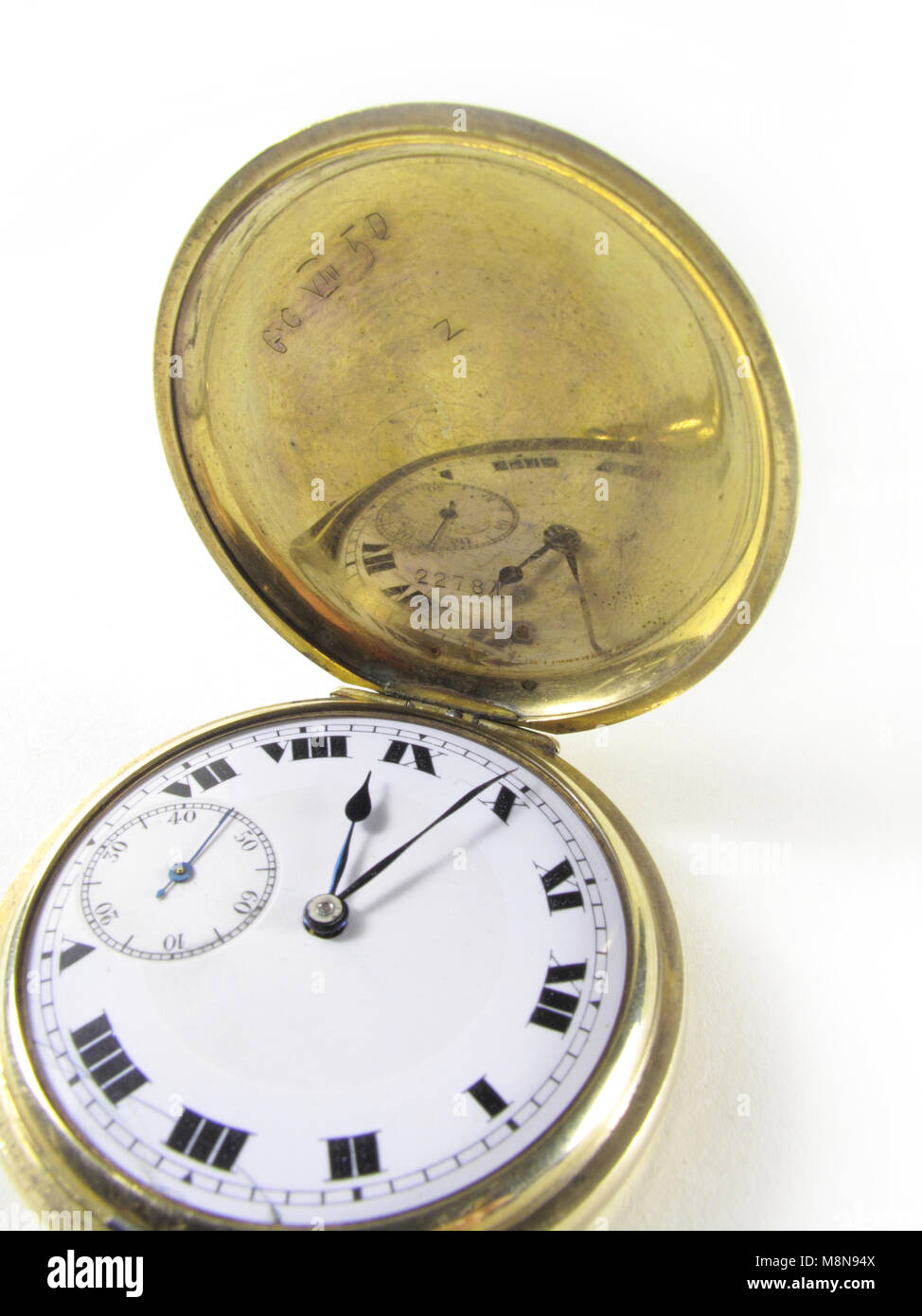 Watch face of an antique gold hunter pocket watch - Stock Image