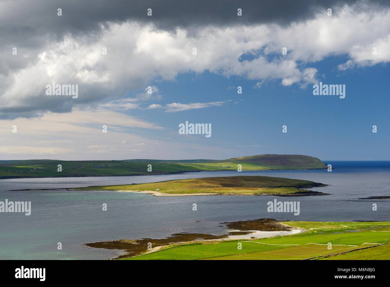 Eynhallow monastic settlement island seen from Westness on Rousay. Orkney, Scotland. Looking west - Stock Image