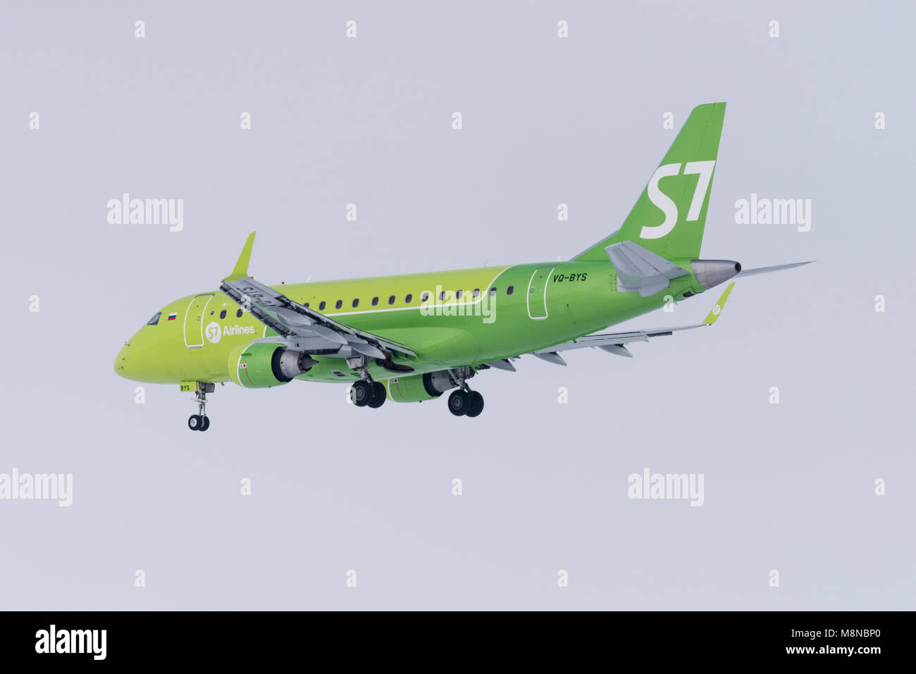 Novosibirsk, Russia - March 10, 2018: Embraer 170-100SU VQ-BYS S7 Airlines approaches for landing at the international - Stock Image