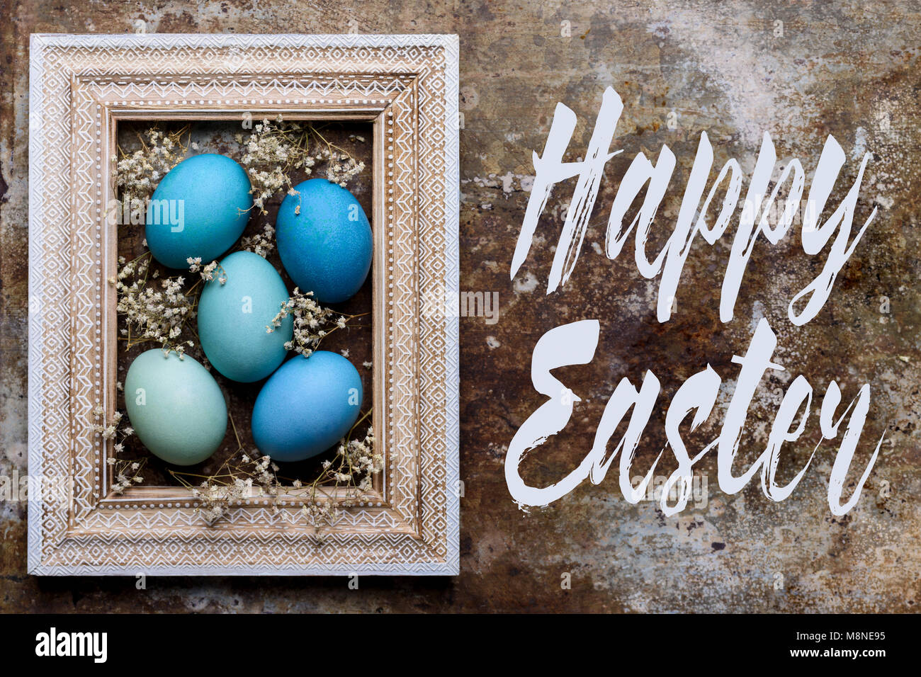 Happy Easter Rustic Background With Copy Space DIY Dyed Various Shades Of Blue Eggs And Vintage Wooden Picture Frame Mock Up