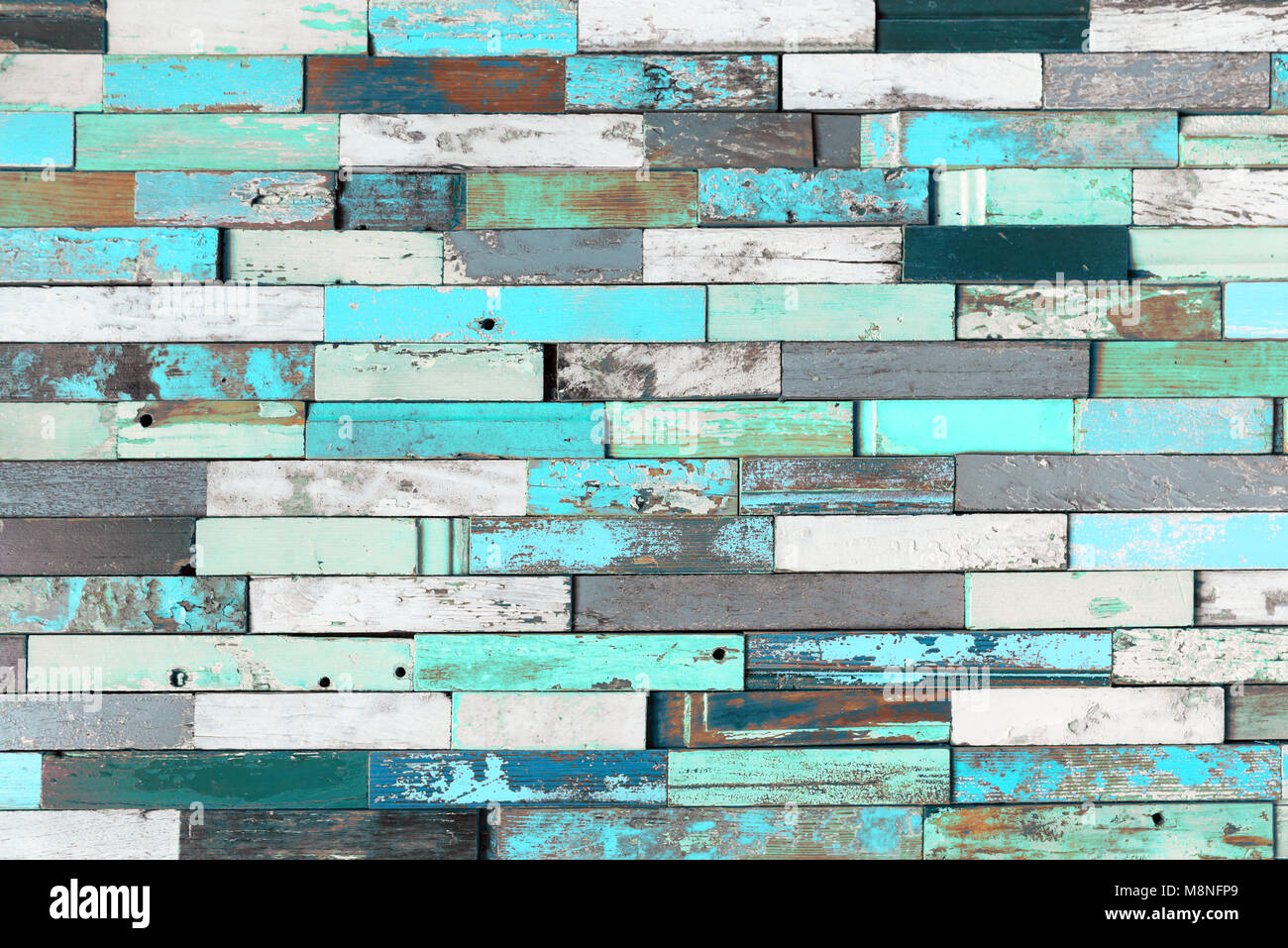 Background of colorful old painted grunge wood planks - Stock Image
