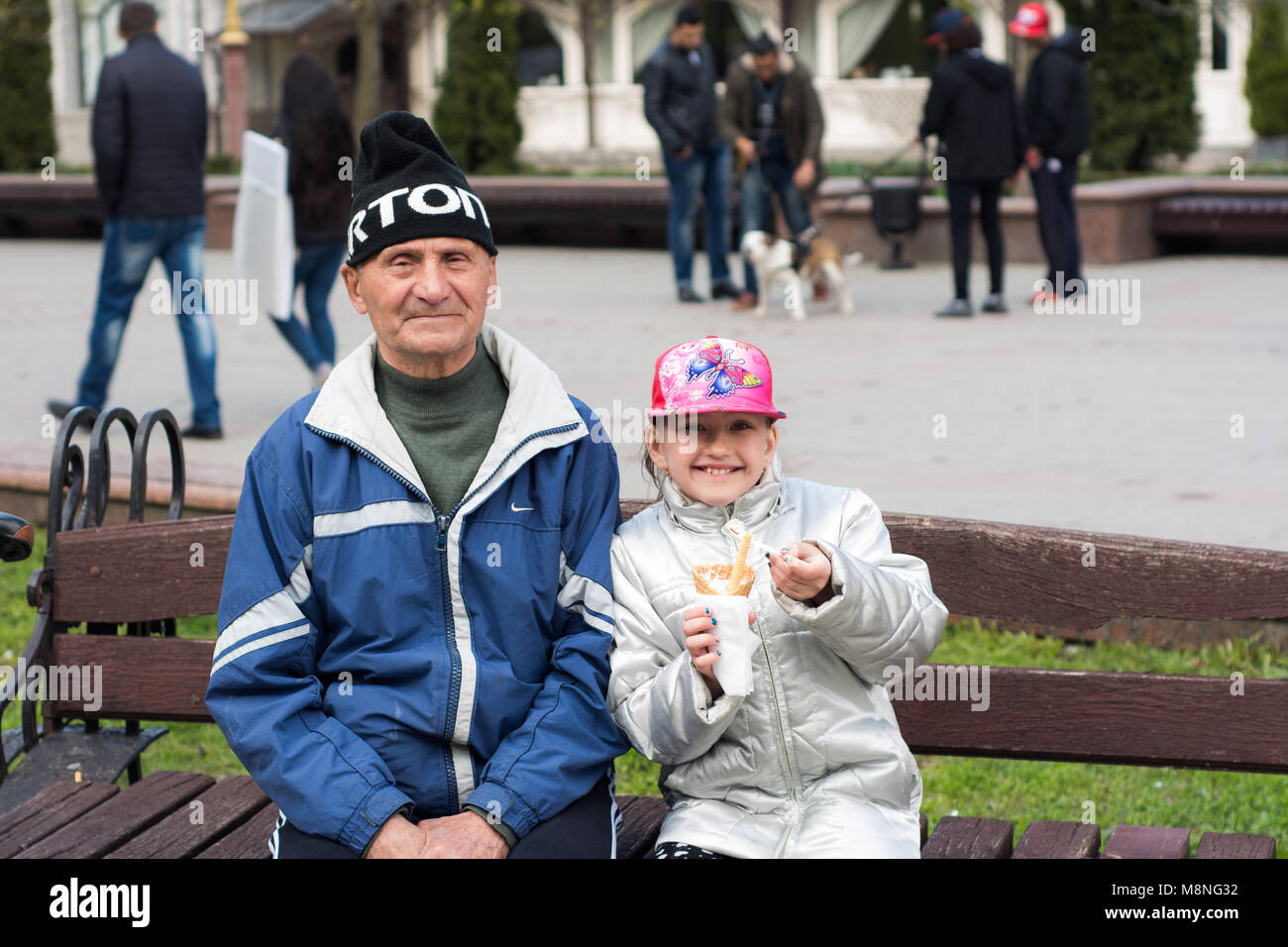 Grandpa and granddaughter. City of Ivano-Frankivsk, Uraine. April 23, 2017 - Stock Image