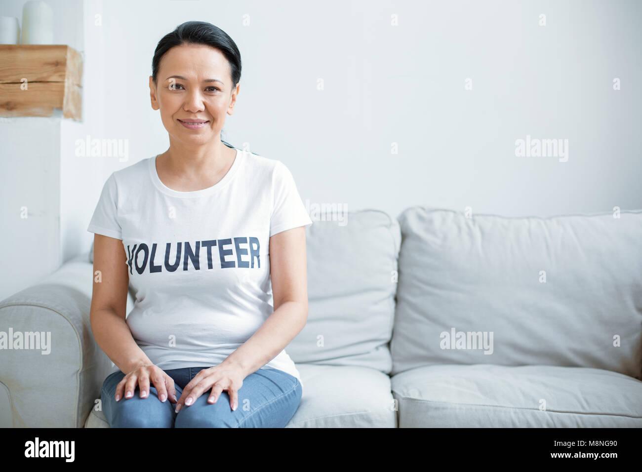 Beautiful female volunteer preparing for service - Stock Image