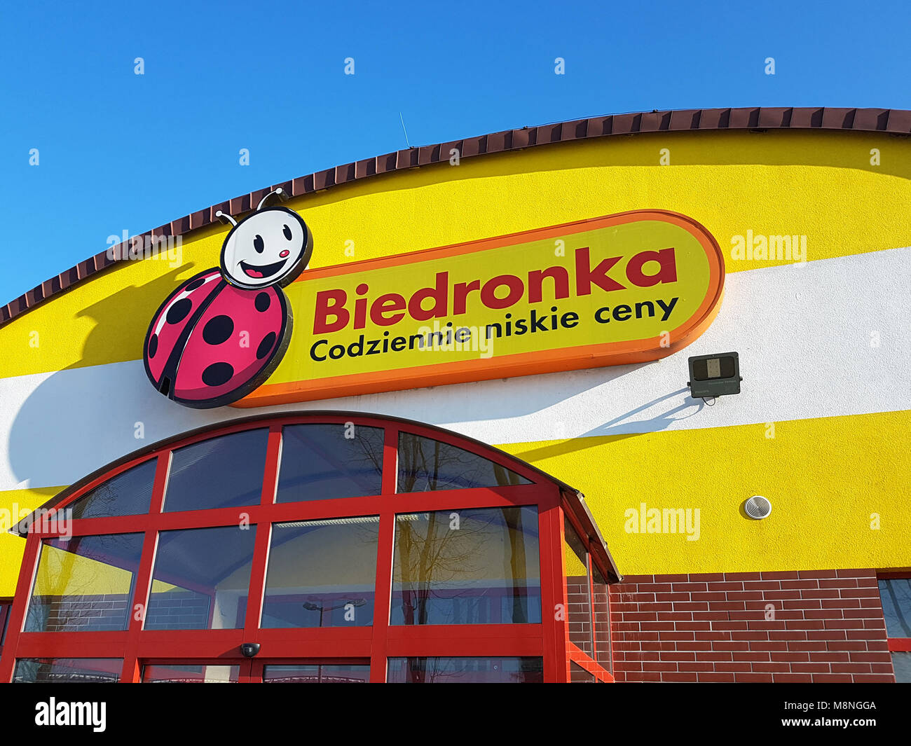 Gorlice, Poland - February 19, 2017: Exterior view of the Biedronka supermarket with the logo situated on the top of the entrance. Stock Photo
