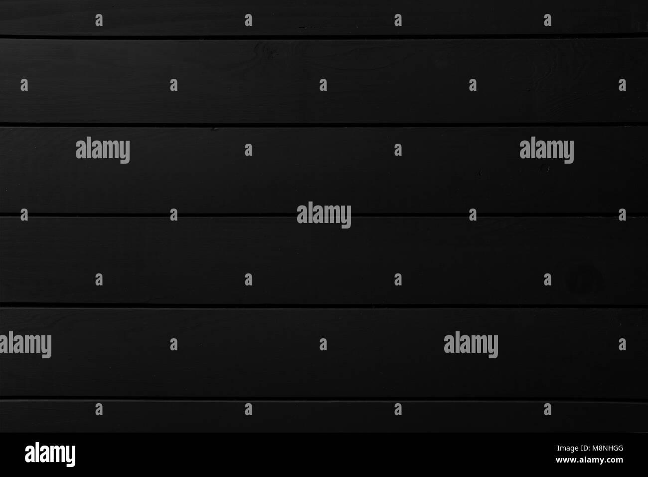 Black vertical wooden planks background - Stock Image