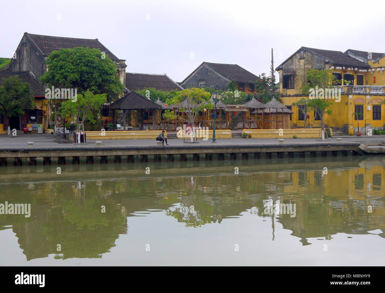 Hoi An, Vietnam - MARCH 17, 2018: Quiet early morning in the old town center of Hoi An Vietnam with view of typical - Stock Image