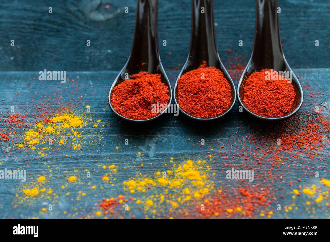 Studio shot of three spoons with paprika powder Stock Photo