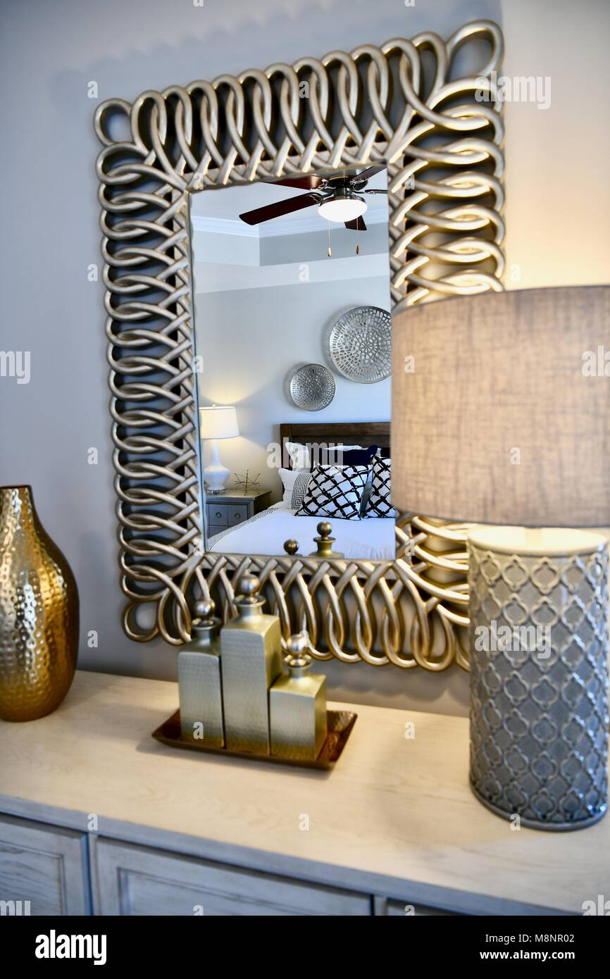 Modern Bedroom Dresser With Gold Accented Decor And Mirror