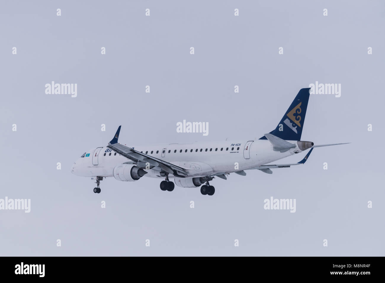 Novosibirsk, Russia - March 10, 2018: Embraer ERJ-190LR P4-KCK Air Astana approaches for landing at the international - Stock Image