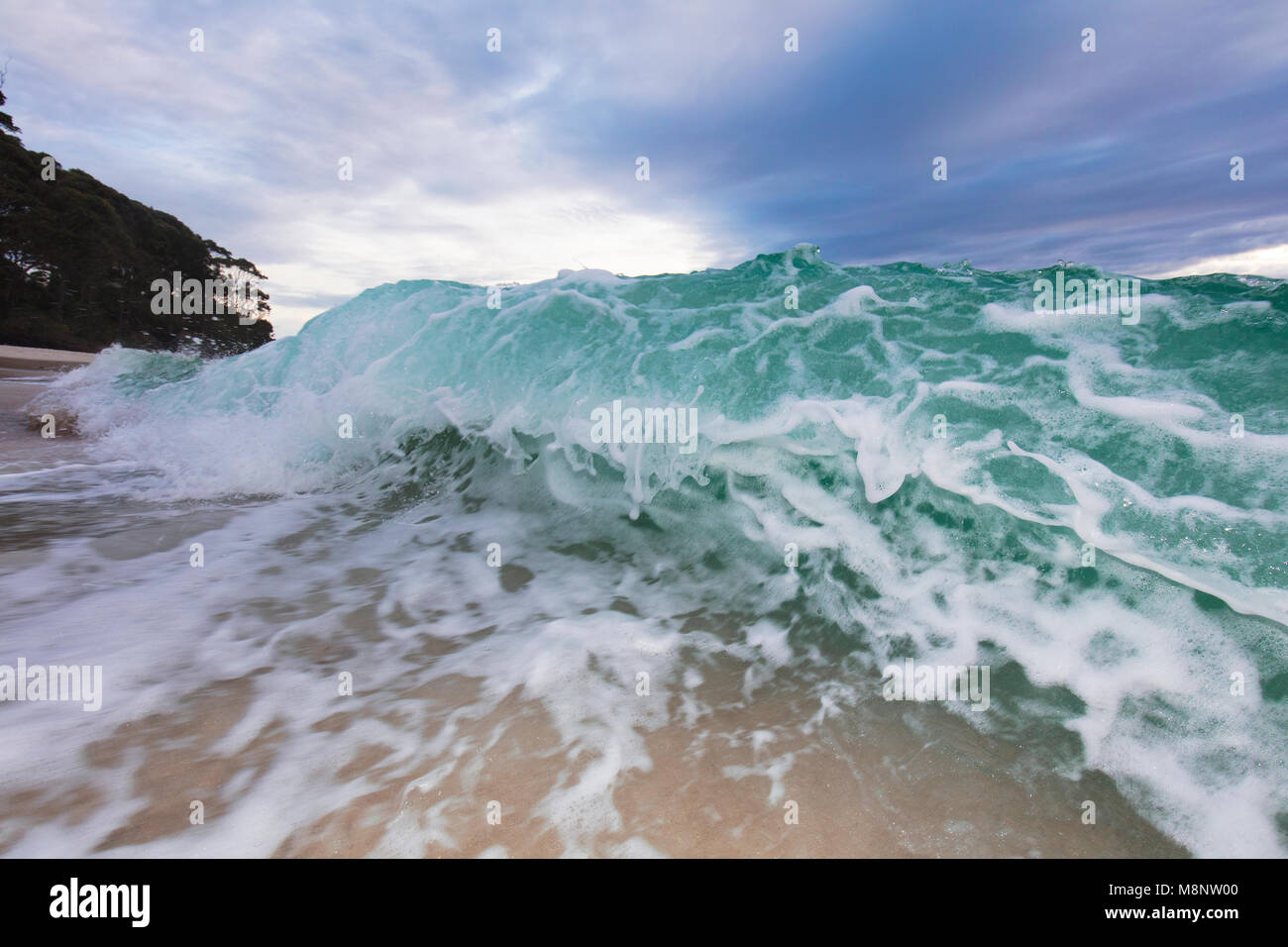 Colourful shore break with lots of energy - Stock Image
