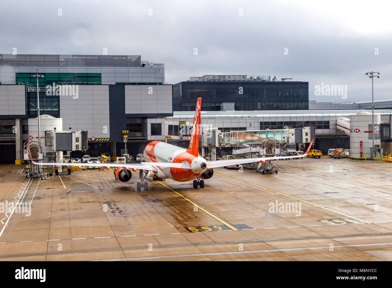 Looking out plane window as it taxi's out at Gatwick airport on a early morning flight to Las Vegas. - Stock Image