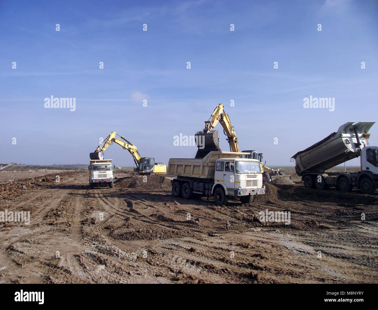 Excavator load trucks - Stock Image