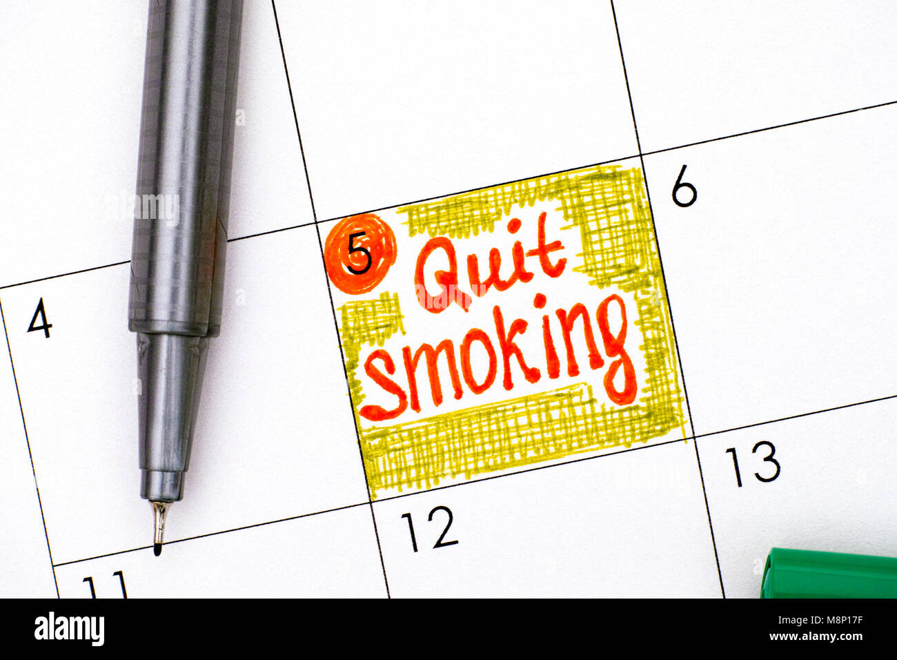 Reminder Quit Smoking in calendar with pen. Close-up. - Stock Image