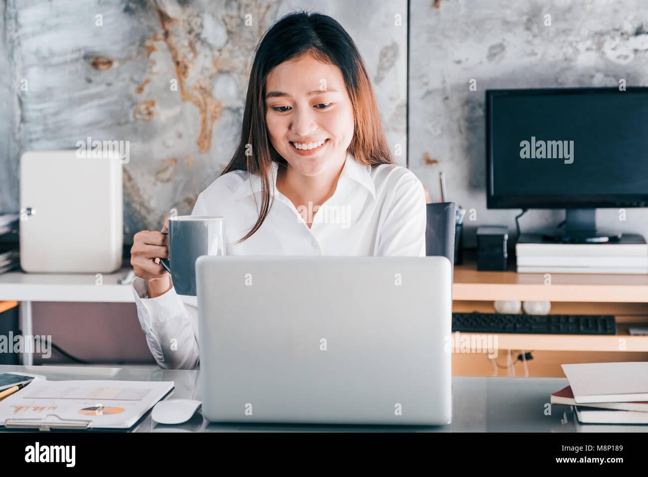 Take Break Coffeebreak : Asian businesswoman take a coffee break after working at laptop