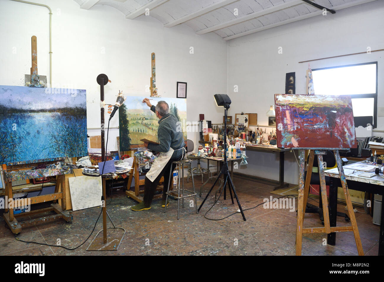 Painter artist painting a picture in the studio Stock Photo
