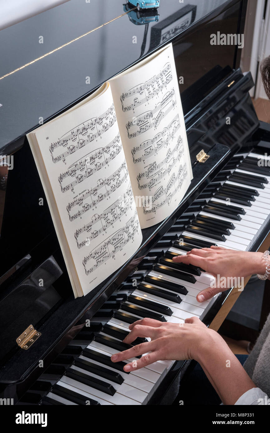 Woman plays  piano -top view Stock Photo