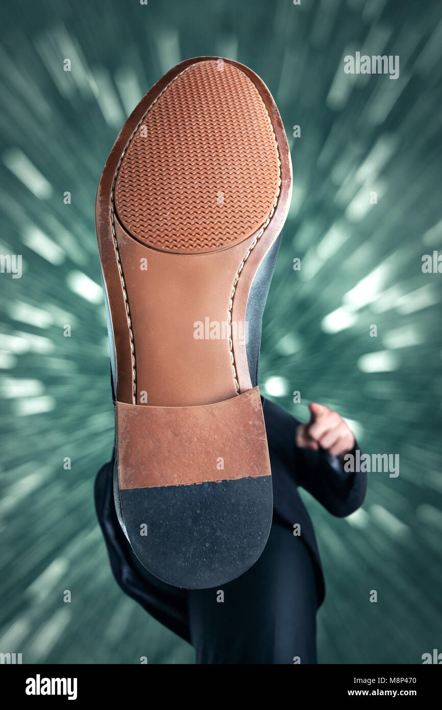 Oppression - illustrated by the underside of a shoe - Stock Image