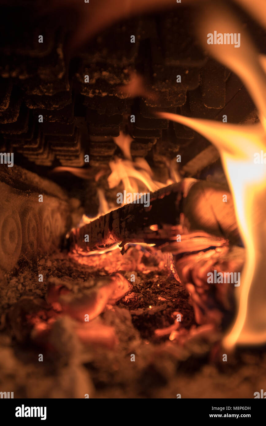 glow and fire inside an old cast iron stove Stock Photo