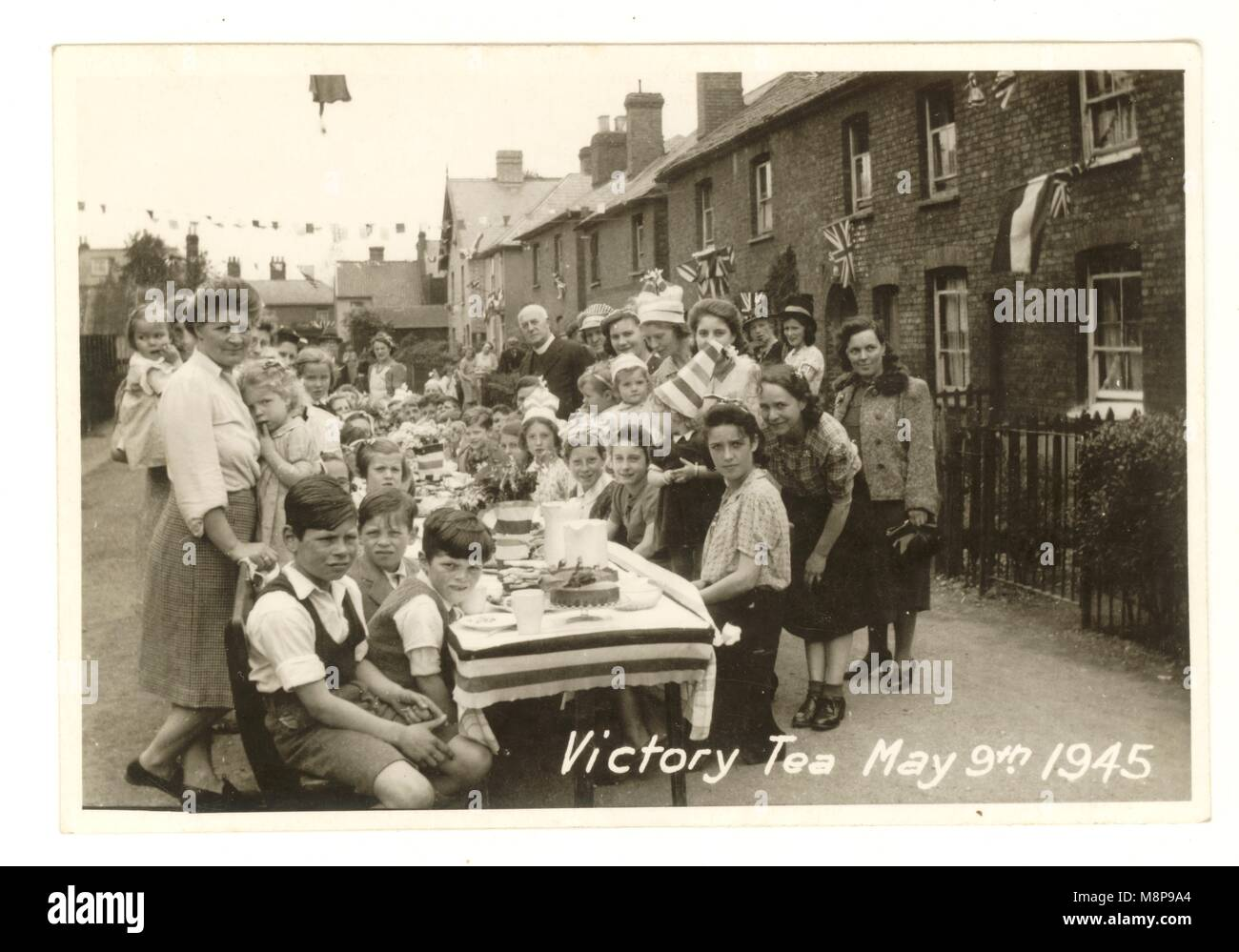 Postcard Victory tea street party, May 9th 1945,to celebrate the ending of 2nd World War, Stanstead Abbbotts, East - Stock Image