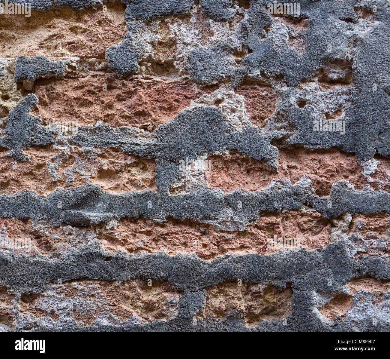 old red brick wall timeworn - Stock Image